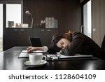 businesswoman taking a nap on... | Shutterstock . vector #1128604109
