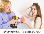 young couple is about to do... | Shutterstock . vector #1128610700