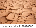 top view dry soil for texture   Shutterstock . vector #1128620000