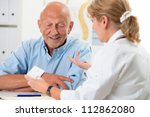 doctor talking to her male...   Shutterstock . vector #112862080