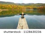 back view of blond hiker woman... | Shutterstock . vector #1128630236