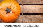Pumpkin Sitting On An Old...