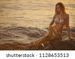 beautiful mermaid sitting on a... | Shutterstock . vector #1128653513