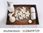many white frangipani in bowl...   Shutterstock . vector #1128659729