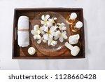 many white frangipani in bowl... | Shutterstock . vector #1128660428