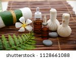 spa setting with orchid oil ... | Shutterstock . vector #1128661088