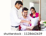 indian office workers... | Shutterstock . vector #1128662639