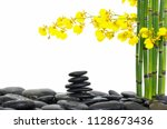 stacked wet stones and yellow... | Shutterstock . vector #1128673436