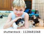 happy caucasian boy lovingly... | Shutterstock . vector #1128681068