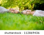 young loving couple lying at... | Shutterstock . vector #112869436