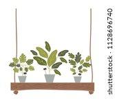 houseplants in swing decorative ... | Shutterstock .eps vector #1128696740