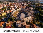 pula arena at sunset   aerial... | Shutterstock . vector #1128719966