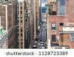 Small photo of New York City, USA - April 7, 2018: Aerial view of urban road from rooftop building in NYC Herald Square Midtown with 35th street, Broadway, cars, traffic, skyscrapers