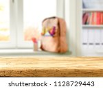 desk of free space and window... | Shutterstock . vector #1128729443