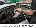 applying  car window tint to... | Shutterstock . vector #1128739946