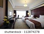 hotel bedroom | Shutterstock . vector #112874278