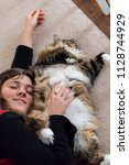 young woman petting one fat... | Shutterstock . vector #1128744929