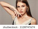 beauty woman face portrait.... | Shutterstock . vector #1128747674