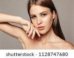 beauty woman face portrait.... | Shutterstock . vector #1128747680