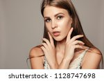 beauty woman face portrait.... | Shutterstock . vector #1128747698