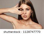 beauty woman face portrait.... | Shutterstock . vector #1128747770