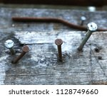 Old Rusty Nails  On The Wooden