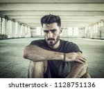 fashionable handsome young man... | Shutterstock . vector #1128751136