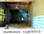 ruined building inside | Shutterstock . vector #1128759773