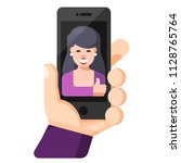 human hand holding mobile phone ... | Shutterstock .eps vector #1128765764
