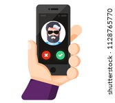 incoming call on smartphone... | Shutterstock .eps vector #1128765770