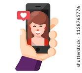 human hand holding mobile phone ...   Shutterstock .eps vector #1128765776