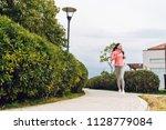 active fast girl jogging... | Shutterstock . vector #1128779084