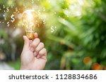 idea of earning money in  hand...   Shutterstock . vector #1128834686