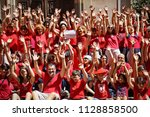 "Small photo of TURIN, ITALY 7th July 2018: FLASH MOB ""A red T-shirt to stop the bleeding of humanity"". Demonstrate in favor of migrants."