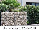 gabion fence wall | Shutterstock . vector #1128863930