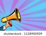 businessman hand holding a... | Shutterstock .eps vector #1128900509