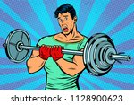 shocked man with a barbell in... | Shutterstock .eps vector #1128900623