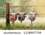 leather saddles ready to put on ... | Shutterstock . vector #1128907739