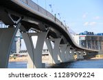 large modern bridge across the... | Shutterstock . vector #1128909224