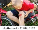 broken wounded knee child.... | Shutterstock . vector #1128910169