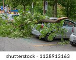 car ruined by the fall of a... | Shutterstock . vector #1128913163