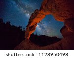 milky way above a desert arch ... | Shutterstock . vector #1128950498