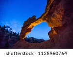 desert arch with night sky ... | Shutterstock . vector #1128960764