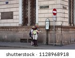 a lost family of tourists with... | Shutterstock . vector #1128968918