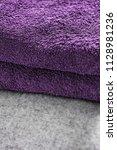 two purple towels folded on a... | Shutterstock . vector #1128981236