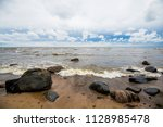 waves of the baltic sea under a ... | Shutterstock . vector #1128985478