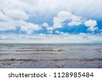 waves of the baltic sea under a ... | Shutterstock . vector #1128985484