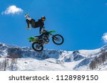 racer on a motorcycle in flight ... | Shutterstock . vector #1128989150