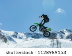 racer on a motorcycle in flight ... | Shutterstock . vector #1128989153