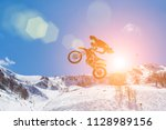 racer on a motorcycle in flight ... | Shutterstock . vector #1128989156